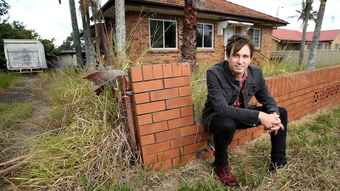 Trent Dalton outside his former home in Darra. Photo courtesy of PerthNow